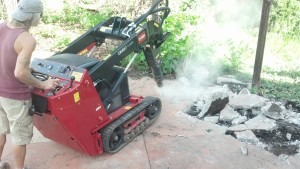 As you can see, this machine has different attachments for different tasks. This particular one is a jackhammer which is great for busting the concrete up.
