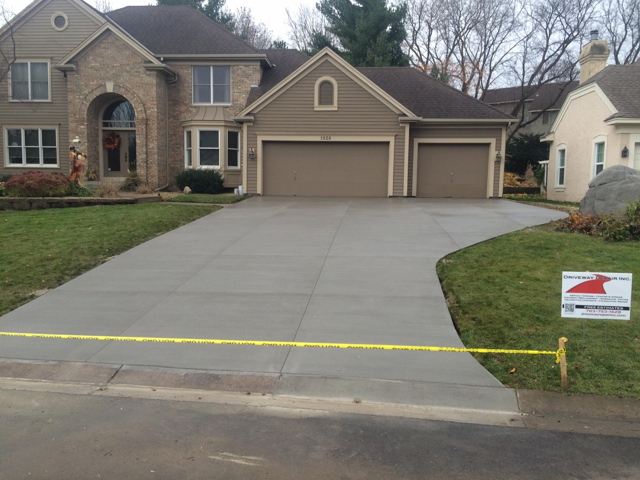 Minneapolis concrete driveways concrete aprons asphalt for Temperature to pour concrete driveway
